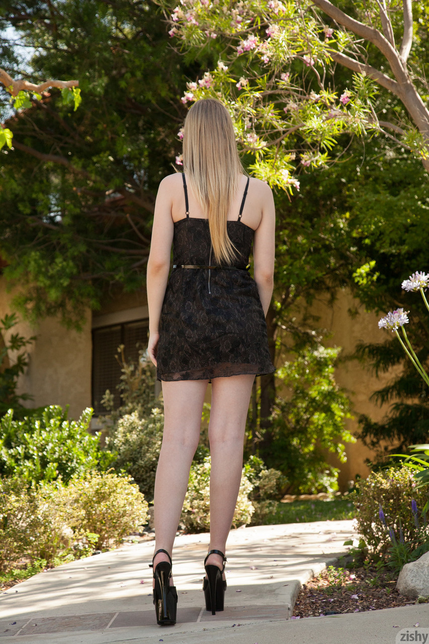 Teen girlfriend Summer Carter slowly takes her dress off and shows pink undies